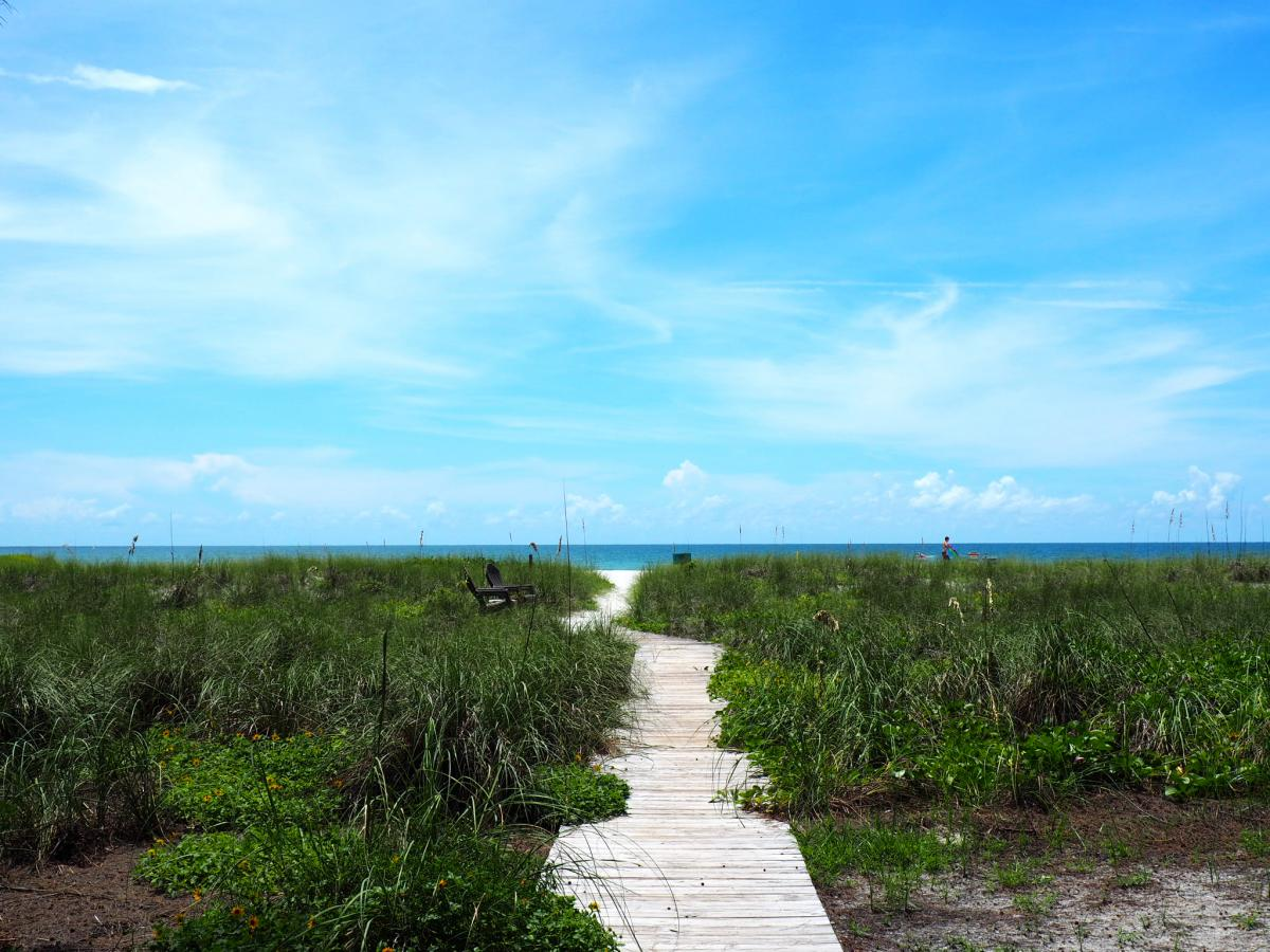 sand walkway to the beach on longboat key in florida