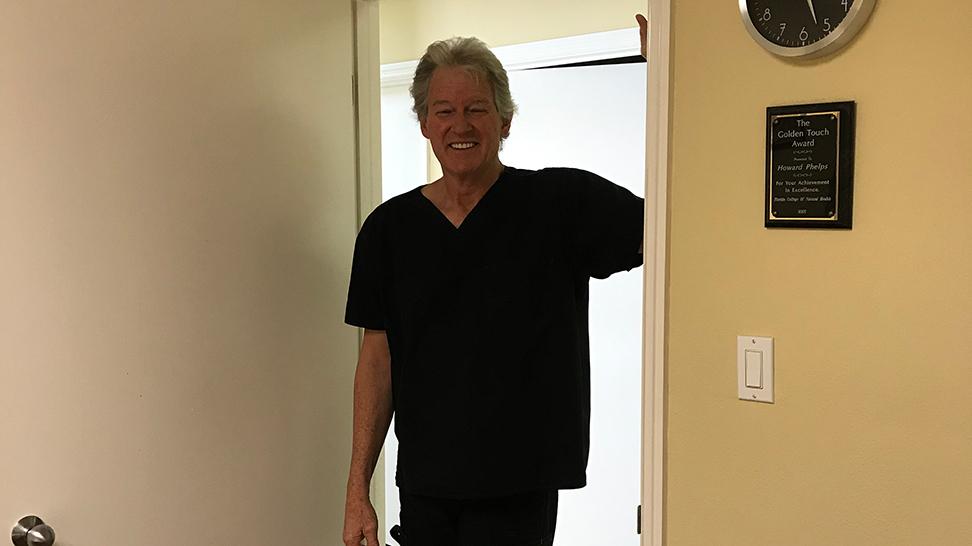 man demonstrating stretch in doorway