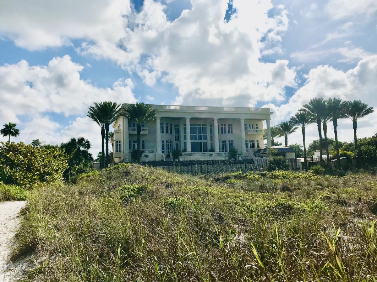 beach view of a mansion on siesta key in florida