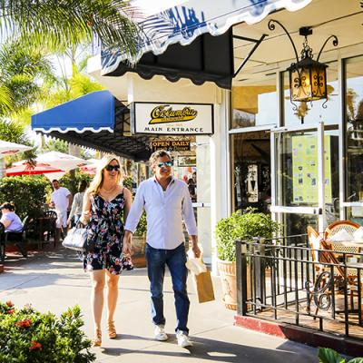 Couple walking through St. Armands Circle