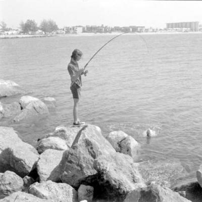 girl fishing in venice