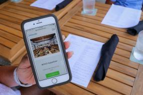 Cell phone showing a Sarasota Big Pass deal