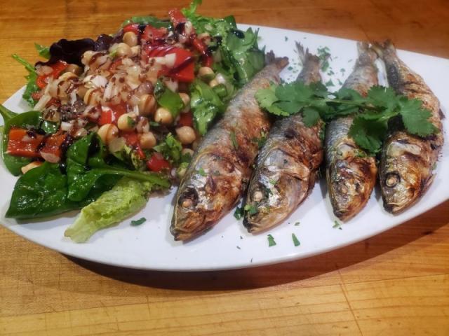 Sardinhas Assadas - Grilled Sardines served with a side of chickpeas salad.