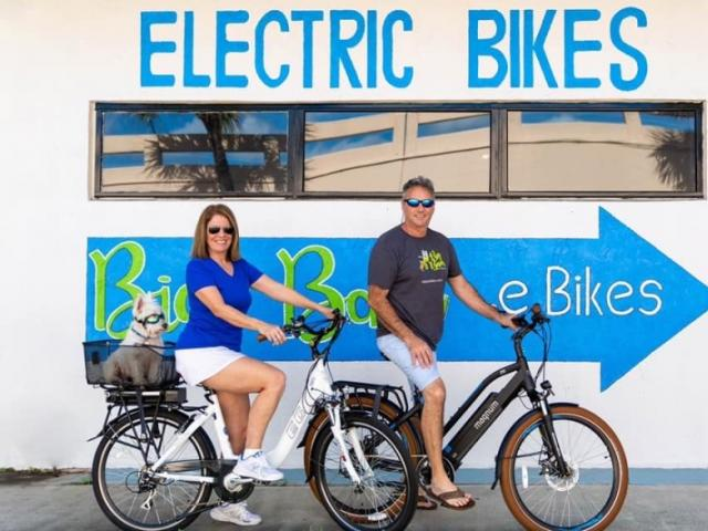 Big Bam Bikes Store Front - Big Bam Bikes store front with owners Pamela, Ray, and Arthur Underfoot Fiume on electric bikes.