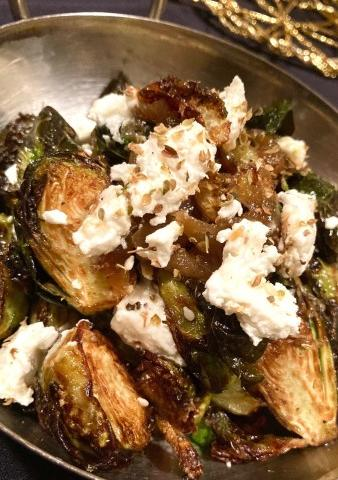 Crispy Brussel Sprouts - Crispy Brussel Sprouts with Caramelized Onions, Ras el Hanout and Crumbled Goat Cheese.