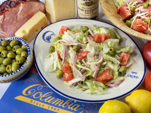 "The Columbia's Original ""1905"" Salad® - The Columbia's Original ""1905"" Salad® The Columbia's legendary salad tossed at your table. Crisp iceberg lettuce with julienne of baked ham, natural Swiss cheese, tomato, olives, grated Romano cheese and our famous garlic dressing. The award-winning salad won honors from USA Today as ""One of 10 Great Places to Make a Meal Out of a Salad."""