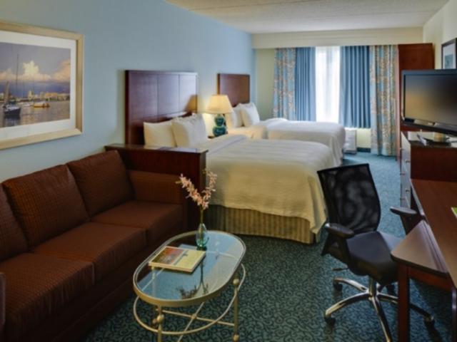 DoubleQueenSleepingRoom.jpeg - All Queen rooms provide two queen size beds, sleeper sofa, refrigerator, microwave and wet bar sink.