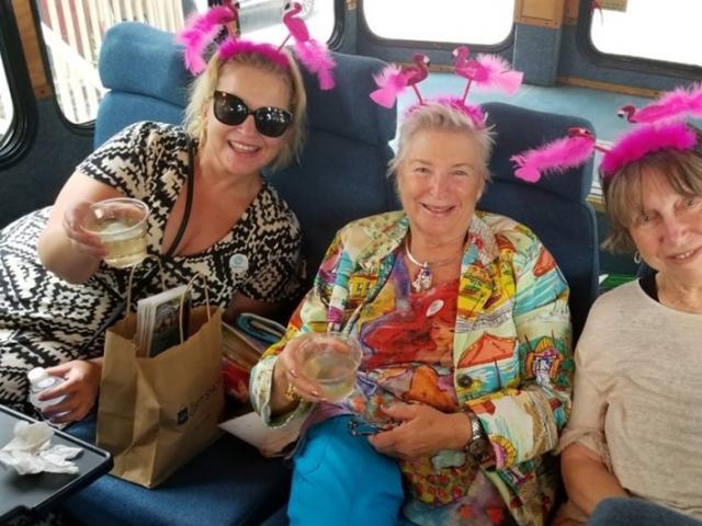 Flamboyance of Flamingos! - Fun ladies enjoying our Tiki Trolley Trivia Tour!