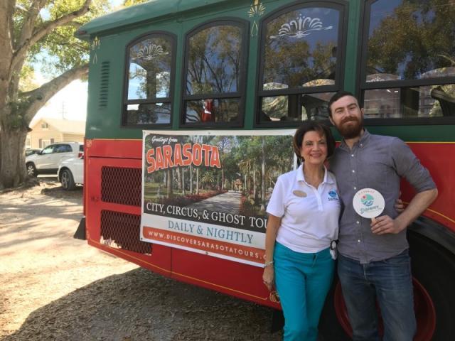 Fan of Discover Sarasota Tours - City guide Kathryn poses with a happy FAN of Discover Sarasota Tours