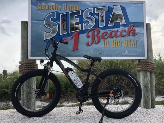 Siesta Beach - Posing with the famous Siesta Beach sign.