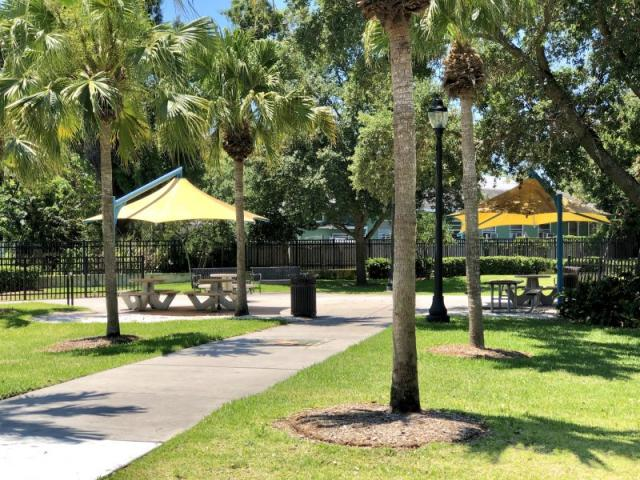 "Fredd ""Glossie"" Atkins Park - Enjoy the day under the fabric shaded picnic tables and seating throughout the park."