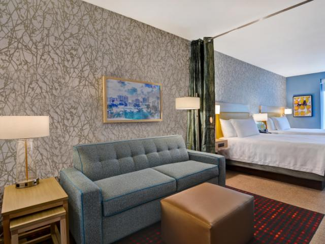 Guest Room - Enjoy your spacious room with an option of one king sized bed or two queen sized bed along with a pull out sofa couch!