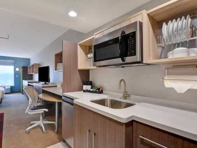 Guest Room - The comfort of home, a spacious guest room along with a full size refrigerator/freezer, dishwasher, microwave kitchenet