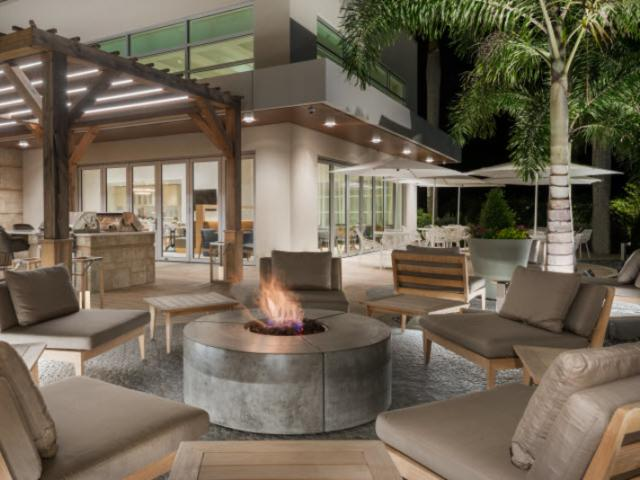 Fire Pit HWS - Homewood Suites by Hilton Sarasota, a fire pit outside for guests to relax and enjoy the evening