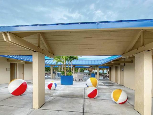 Lido Beach Pavilion Entrance - CONCRETE BEACH BALLS Definitely not meant for playing with on the beach, these fun beach balls at the Lido Beach Pavilion weigh in at over 1,000 lbs. each, with the largest weighing 2,500 lbs.! The decorations add a pop of color and double as eye-catching chairs!