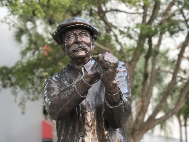 """Royal St. Andrews — Father of Golf - Links Plaza is where, in 1905, Col. John Hamilton Gillespie created the first golf course in Sarasota. The Jack Dowd-designed bronze sculpture of Col. Gillespie called the """"Royal St. Andrews — Father of Golf"""", overlooks the fountain."""