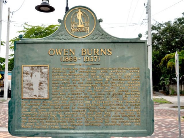 Owen Burns Historical Marker and Burns Court Herald Square - Owen Burns was one of Sarasota's most distinguished citizens and connected with virtually every early development of the city. He first came to Sarasota on vacation from Chicago in 1910 and decided to make it his home. He purchased more than 75% of the land area of the city, making him the largest landowner.  Burns helped organize the Sarasota Board of Trade in 1911, was instrumental in founding the first locally owned bank, and was a leader in the push to divide Sarasota County from Manatee County in 1921.  His other activities included the effort to have the city's first streets paved and the construction of Sarasota's first seawalls. He oversaw the development of the bayfront subdivisions of Cedar Point and Sunset Park and of Washington Park, just east of this site. His Burns Construction Company built the Ringling causeways connecting Sarasota to St. Armands Key, and Lido Key. At one time, he owned all of Lido Key. He was initially involved with John Ringling in the development of St. Armands and John Ringling Estates. During the 1920s, his construction firm was responsible for the construction of some of Sarasota's most notable buildings, including John and Mable Ringling's home, Ca'd'Zan.