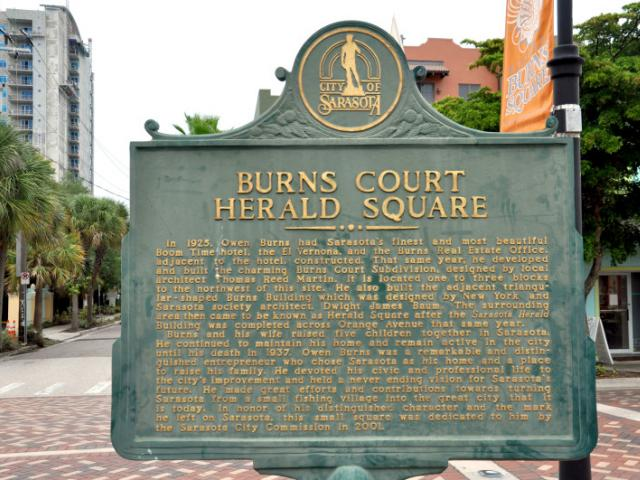Owen Burns Historical Marker and Burns Court Herald Square - Reverse Side:  Burns Court Herald Square  In 1925, Owen Burns had Sarasota's finest and most beautiful Boom Time hotel, the El Vernona, and the Burns Real Estate Office, adjacent to the hotel, constructed. That same year, he developed and built the charming Burns Court subdivision, designed by local architect Thomas Reed Martin. It is located one to three blocks to the northwest of this site. He also built the adjacent triangular-shaped Burns Building which was designed by New York and Sarasota society architect, Dwight James Baum. The surrounding  area then became known as Herald Square after the Sarasota Herald building was completed across Orange Avenue that same year.  Burns and his wife raised five children together in Sarasota. He continued to maintain his home and remain active in the city until his death in 1937. Owen Burns was a remarkable and distinguished entrepreneur who chose Sarasota as his home and a place to raise his family. He devoted his civic and professional life to the city's improvement and held a never ending vision for Sarasota's future. He made great efforts and contributions towards turning Sarasota from a small fishing village into the great city that it is today. In honor of his distinguished character and the mark he left on Sarasota, this small square was dedicated to him by the Sarasota City Commission in 2001.