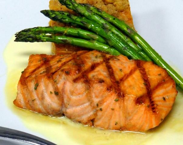 Rosemary Honey Glazed Salmon - Delicious filet of Salmon served with crispy fingerling potatos, asparagus, and a citrus beurre blanc
