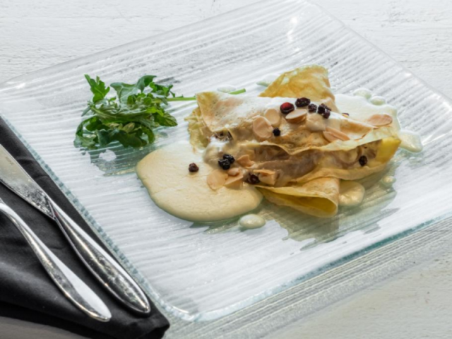 Duck Brie Crepes - Duck Brie Crepes - shredded duck, brie, currants, almonds, brandy cream sauce