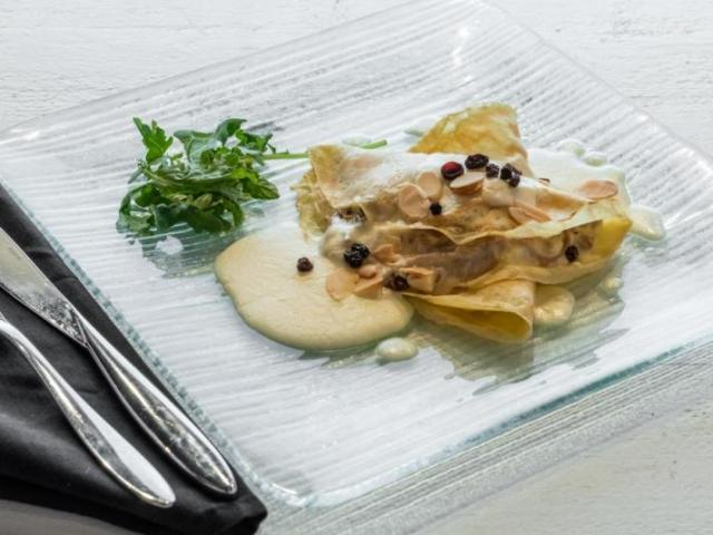 Duck Crepes - Shredded duck, brie, currants, almonds, with a brandy cream sauce