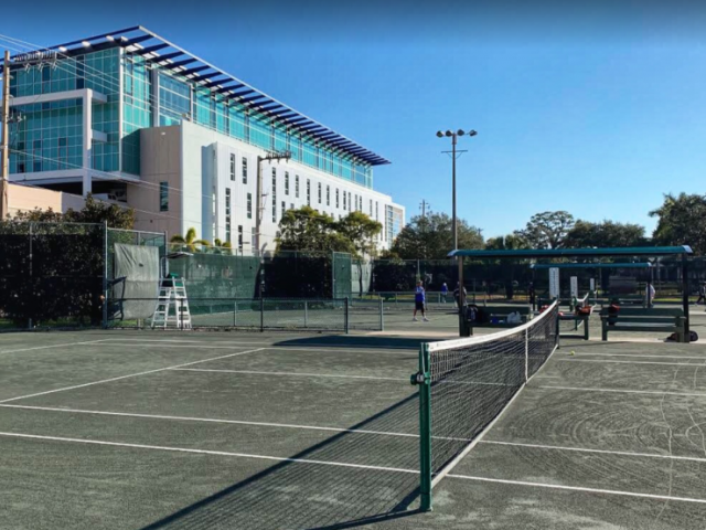 Tennis Center - Twelve Har-Tru Hydrogrid tennis courts, hitting wall, covered bench seating, and a locker room with showers. Offers lessons/clinics, tournaments, and evening play on lit courts.