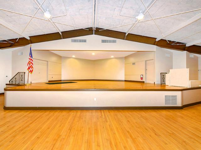 Large Stage - The room has a well maintained 4,000 plus square foot hard wood floor suitable for dances and meetings. There is a large well lit stage for bands, performances or presenters.