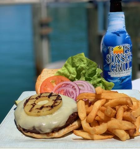 Harbour Island Bahame Mama - Our Burgers are 8oz all Beef patties cooked on the grill.  The Island Harbour Bahama Mana is topped with a slice of Pineapple and Mozzarella Cheese with mild Teriyaki Sauce, Lettuce, Tomato and a choice of side item.