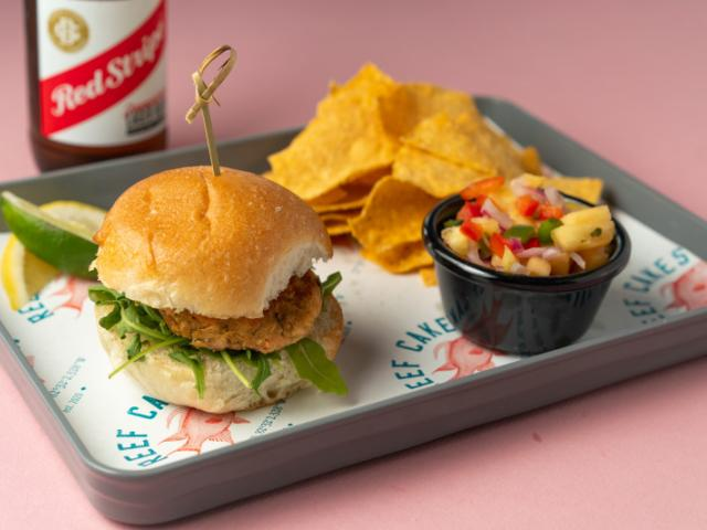 Rank'n Dan - Cajun Snapper & Shrimp Reef Cake Slider, Old Florida Gourmet Lime Tortilla Chips & Caribbean Salsa. Served with a Cold Red Stripe Beer