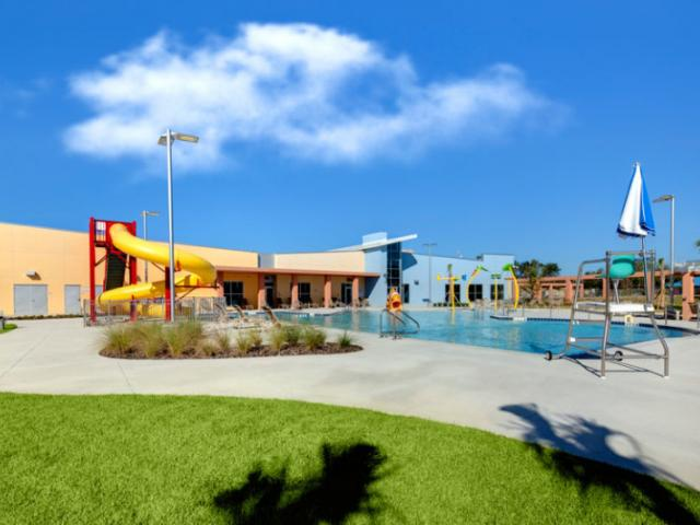 Pool Features - Zero Entry, Splash Pad Zone, Small Slide, Large Slide, Jacuzzi Section, Lap Lanes and plenty of outdoor seating and access to locker rooms.