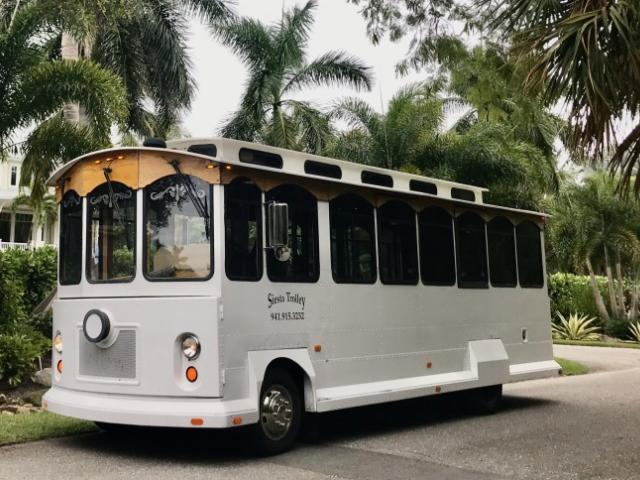 Wedding Trolley - These White Wedding Trolleys range in size from 26 passenger to 36 passenger capacity.