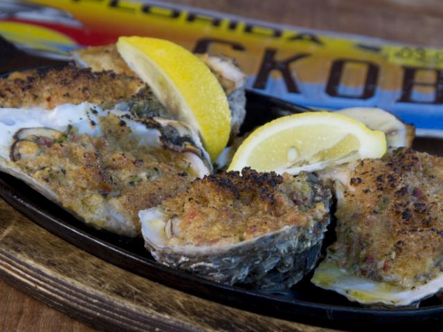Baked Oysters - 8 Baked Oysters choose from Rockefeller, Garlic Parmesan, Casino, or Buffalo style. Casino style pictured here!