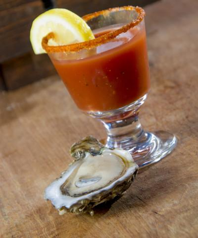 Oyster Shooter - Absolut Peppar, Bloody Mary Mix, a dash of Horseradish and an ice cold Oyster on the Half Shell!  A SKOB Favorite!