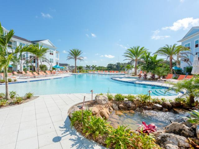 Beach Entry Resort Pool - The Floridian Club of Sarasota's gem is its beach entry resort pool, complete with a BYOB Tiki Bar, Towel Service, fire pits, spa hot tub, and outdoor game area.