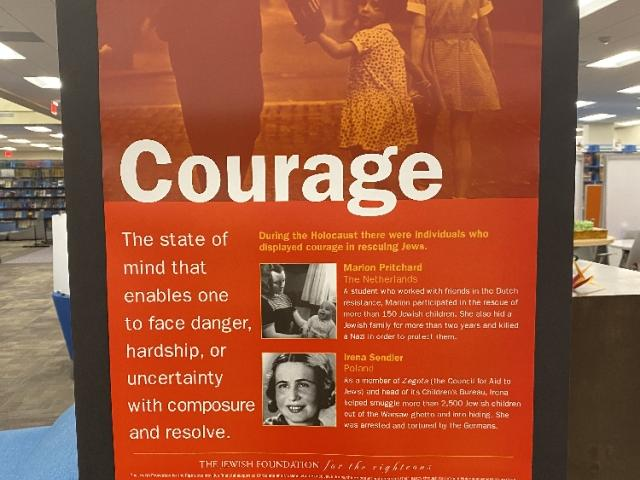 "One of the features of the exhibit is a series of posters displaying eight ""Traits That Transcend."""