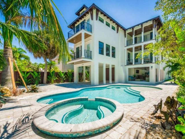 Shore House - This absolutely stunning, 3 level Lido Key Coastal Home features 7 Bedrooms - including a Huge Master Bedroom with En Suite Bathroom, and 4.5 Bathrooms throughout the home.