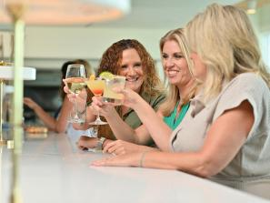 Women drinking cocktails at Drift Kitchen on Lido Key