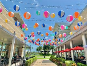 beach balls handing over a walkway at the Mall at UTC