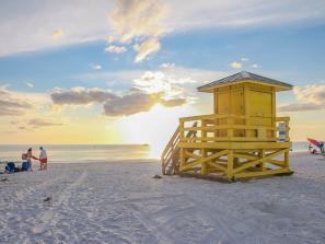 yellow lifeguard tower on siesta key beach in florida