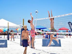 Teams playing beach volleyball on siesta key