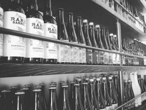 99 Bottles Taproom & Bottle Shop - shelves full of a well-curated selection of exceptional craft beer...