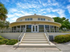 """John Chidsey"" Bayfront Community Center - The ""John Chidsey"" Bayfront Community Center is attached to the west side of the historic Sarasota Municipal Auditorium. This quaint little venue has stunning views of the Sarasota Bay and offers a 2,000 square foot facility that is ideal for dances, church socials, meetings, parties and seminars. The space can accommodate 80 guests for a sit down catered function or up to 175 theater seating style!"