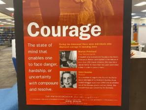 """One of the features of the exhibit is a series of posters displaying eight """"Traits That Transcend."""""""