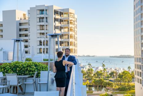 two people standing at a rooftop bar in sarasota, florida