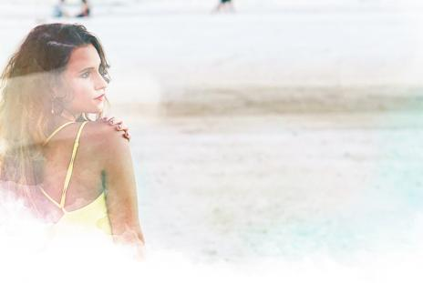 A girl looks out at Siesta Key, the no. 1 beach in America, as voted on by TripAdvisor Reviewers