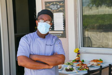 Chef standing outside restaurant