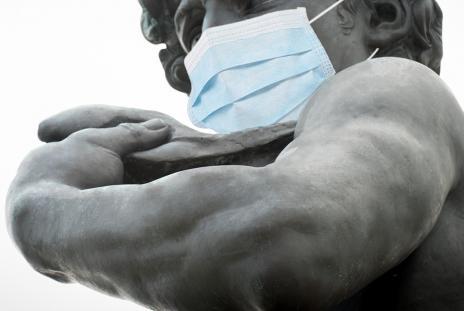 statue wearing a mask