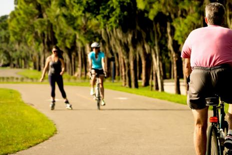 Two bicyclists and a roller skater at Nathan Benderson Park.  Photo credit: Eddie Kirsch