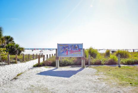 siesta key #1 sign at beach entrance