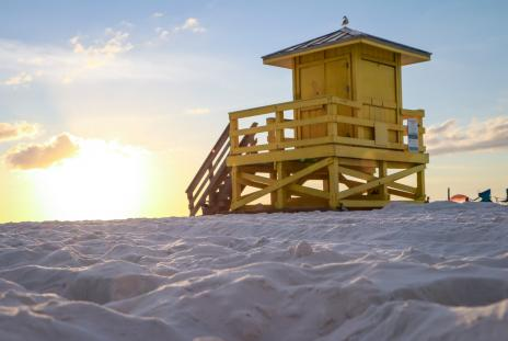 sand and lifeguard stand on siesta key in sarasota florida